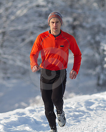Running athlete in the snow