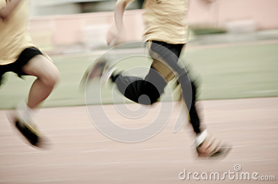 Running child on sport track