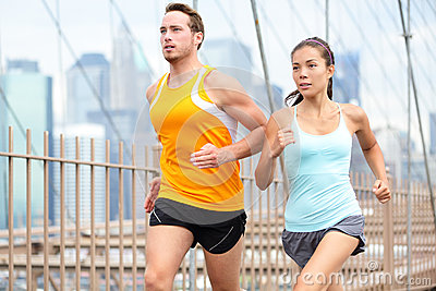Running couple jogging in New York City