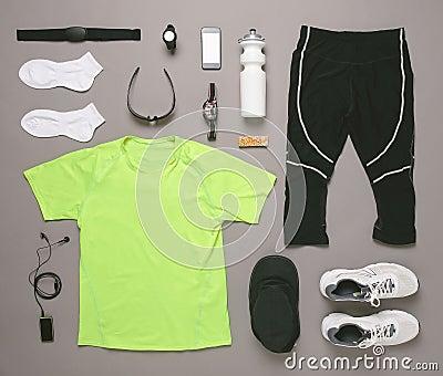 Running equipment man on grey background.