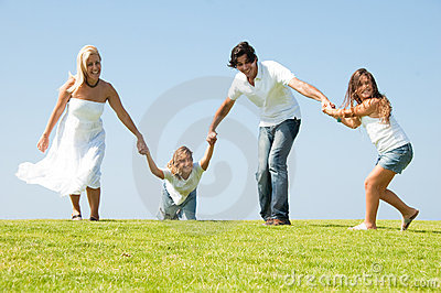 Running family on meadow