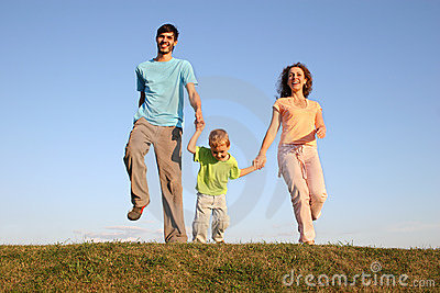 Running family on meadow 2
