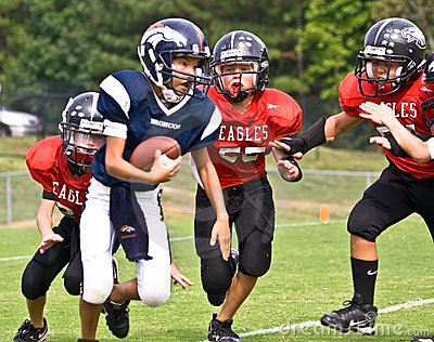 Running a Football/Youth League Editorial Stock Photo