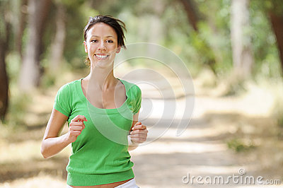 Running in green forest