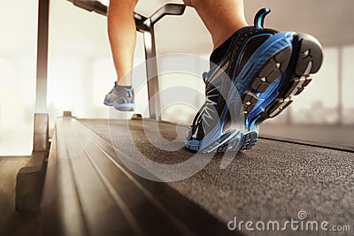 Running in a gym on treadmill