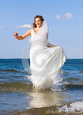 Running laughing bride