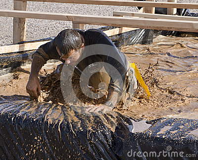Running, Mud, and Obstacle Course Editorial Stock Photo