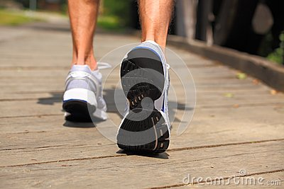 Running in park - close-up on sport shoes and legs