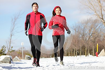 Running. Runners exercising in winter
