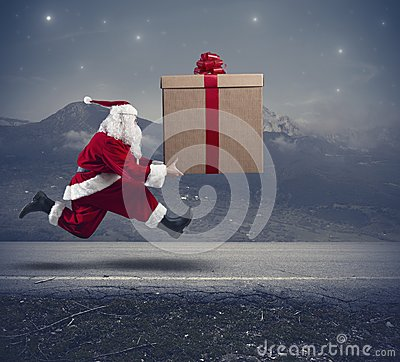 Free Running Santa Claus With Big Gift Royalty Free Stock Image - 34042746