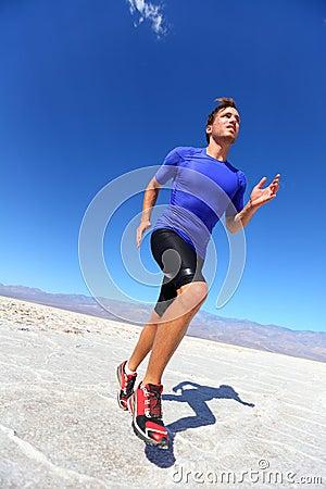 Sport athlete man sprinting in trail run in desert male fitness
