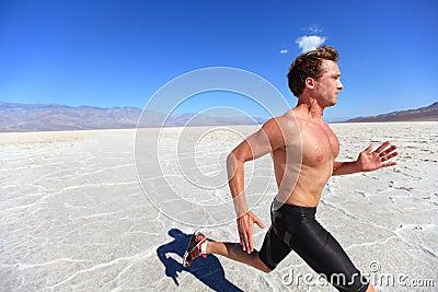 Running sport man - fitness runner in desert