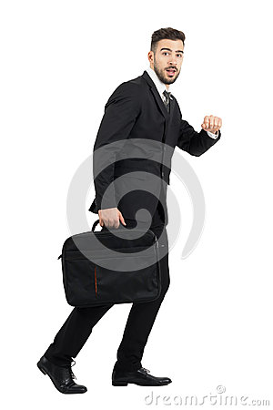 Free Running Surprised Business Man Carrying Laptop Case Side View Looking At Camera Royalty Free Stock Image - 63652596