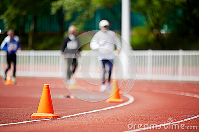 Running track at stadium with runners