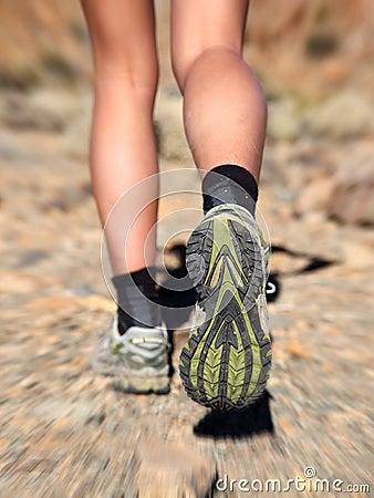 Running trail shoes - feet / legs closeup