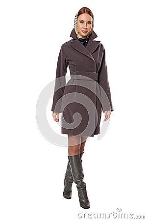 Running woman in coat