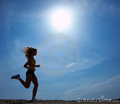 Running woman with sky