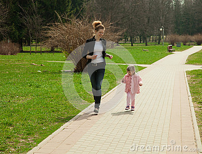 Running young mother and her daughter