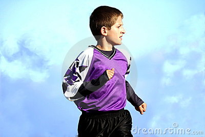 Running youth soccer player