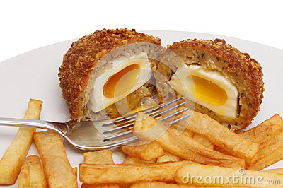Runny scotch egg and chips