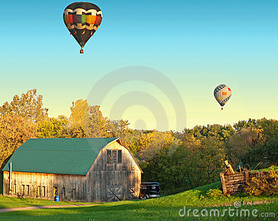 Rural barn and balloons scene