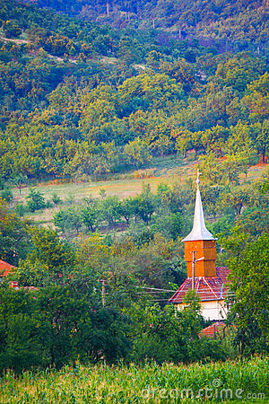 Rural church by hillside
