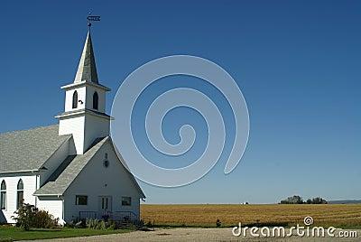 Rural Church near farmer field
