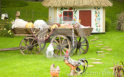 Rural cottage and vehicles or wagons