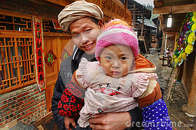 Rural family of Asia, father holding baby in her arms. Editorial Photography
