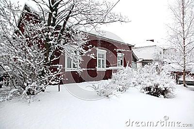 Rural house under snowfall