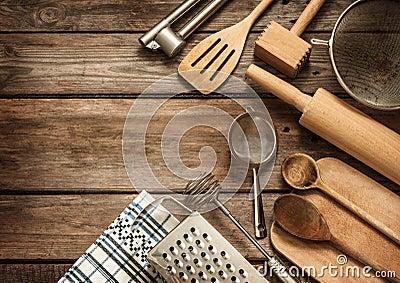 Rural kitchen utensils on vintage planked wood table
