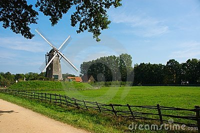 Rural landscape with windmill.