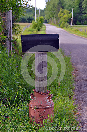 Rural Mailbox in Rusty Old Milk Can