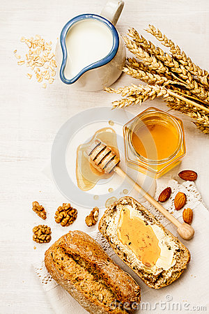 Free Rural Or Country Breakfast - Bread Rolls, Honey Jar And Milk. Royalty Free Stock Photography - 50370397