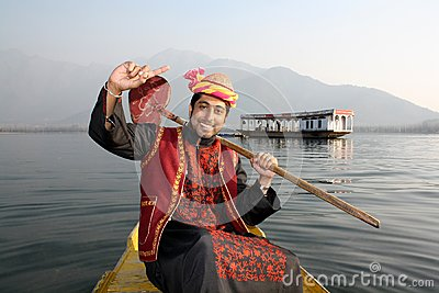 Rural Pathani Boy Singing on a Boat Hand Raised