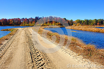 Rural Sand Dirt Road in Marsh Wetland Countryside