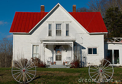 Rural white house with a red roof