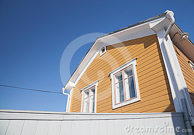 Rural yellow wooden house