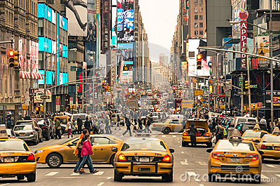 Rush hour with cabs and melting pot people in New York