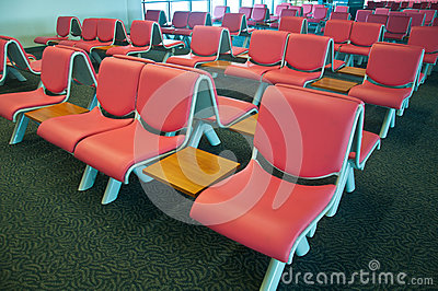 Rushed passengers in the airport waiting room