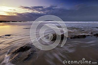 Rushing waves on the beach.