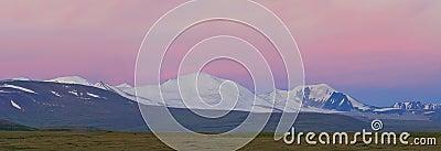 Russia. Siberia. Altai. View on white snow summits