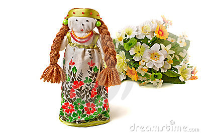 Russian doll in dress and a bouquet of flowers.