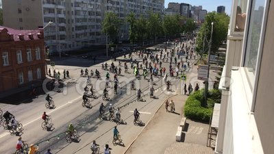 Russian Federation, Respublic of Bashkortostan, Ufa. May 2019. Lot of cyclists ride cycling bike, bicycle parade by city street Ts. Urupi. Crowd of people on stock video