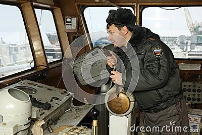 Russian  militiaman is on captain s bridge