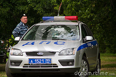 Russian police officer with a police car Editorial Photography