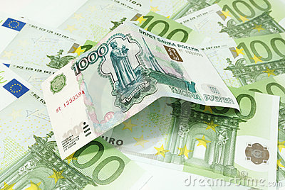 Russian roubles on background of euro banknotes