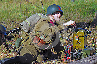 Russian soldier-reenactor picks up the phone Editorial Stock Photo