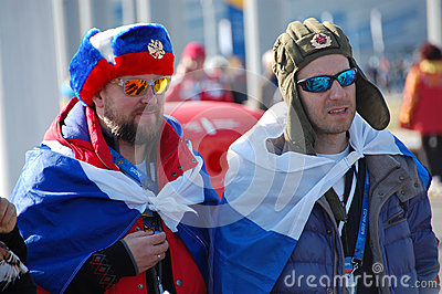 Russian spectators with flags at XXII Winter Olympic Games Sochi Editorial Photo