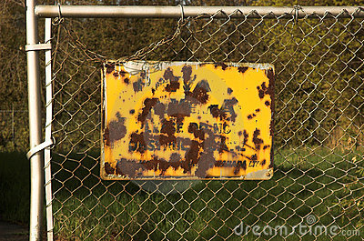 Rusted Fence Sign